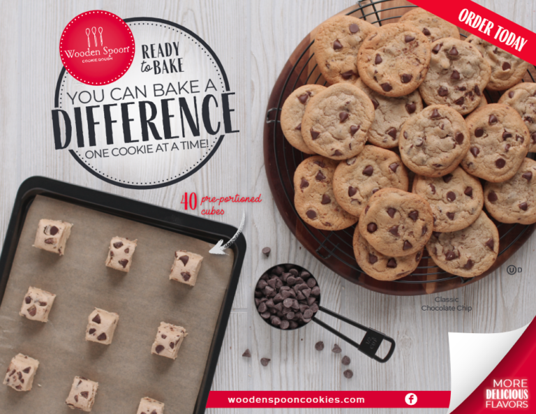 Ready to Bake: You Can Bake a Difference Wooden Spoon cookie dough order form. Cookie dough cubes on tray and baked cookies on wooden plate with wire rack. Chocolate chips in measuring cup.